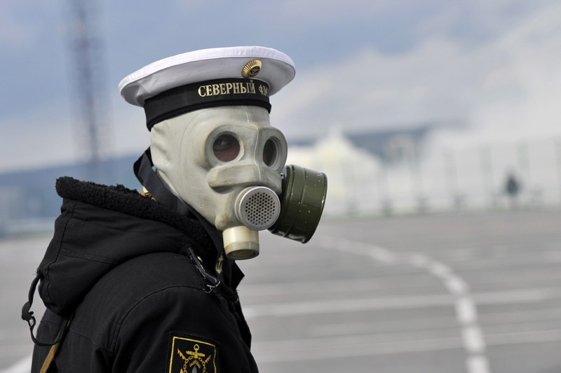 A person in a Russian military uniform and a gas mask, seen from the shoulders up.