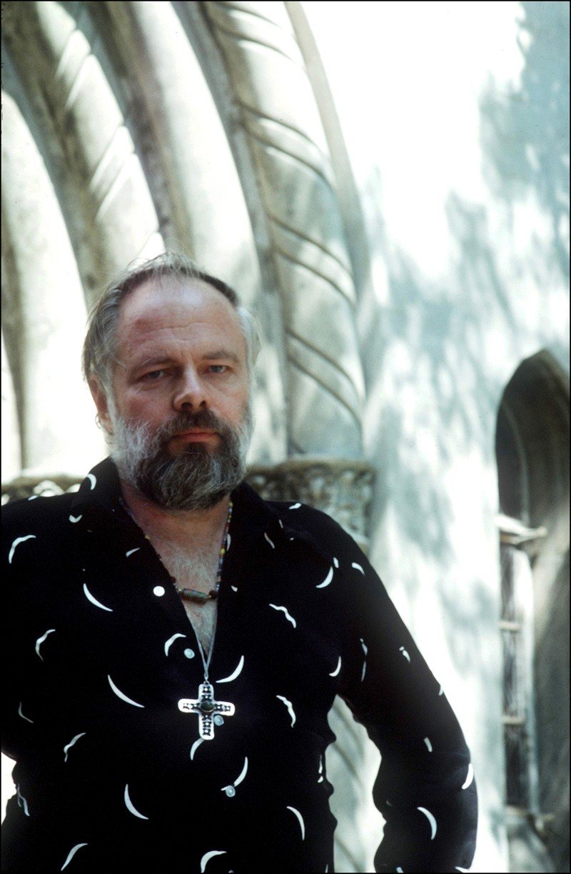 Philip K. Dick, a white man with a beard, wearing a black shirt.