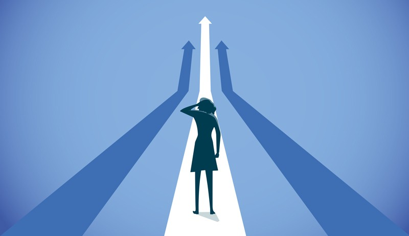 Cartoon image of woman's silhouette, gazing into the distance at several possible paths