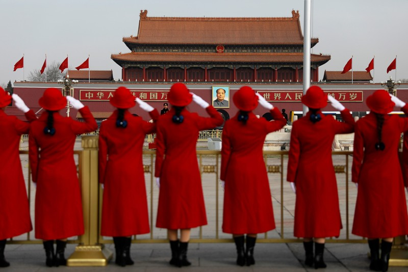 Chinese stewardesses salute in Tiananmen Square