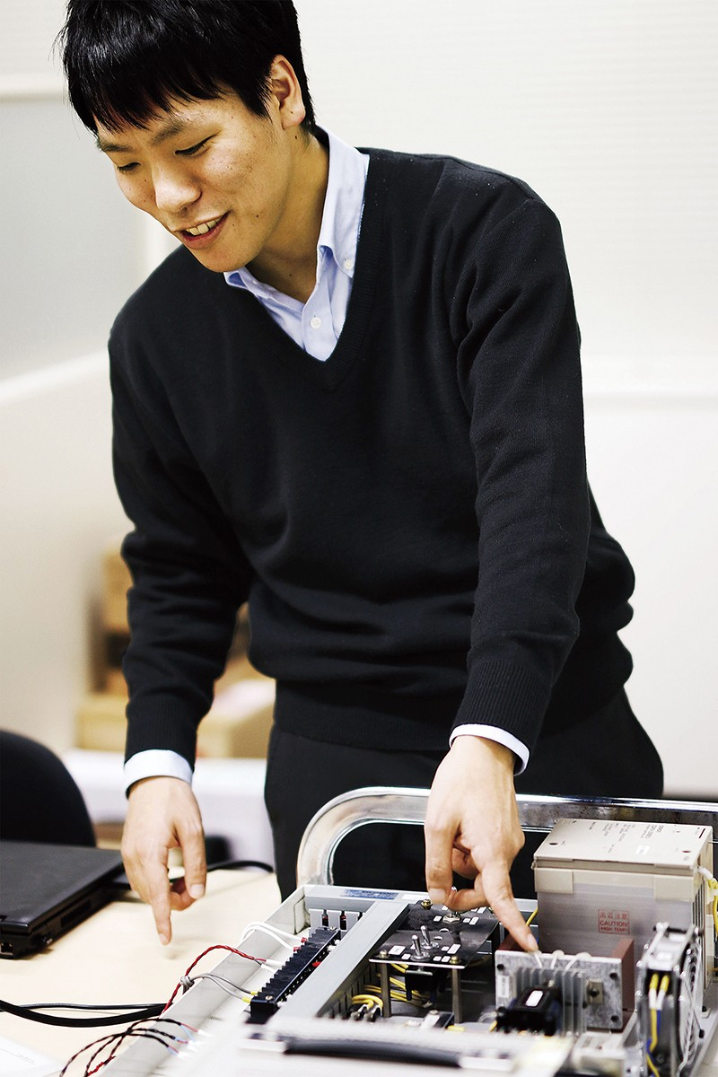 A researcher at the Control System Engineering Laboratory.