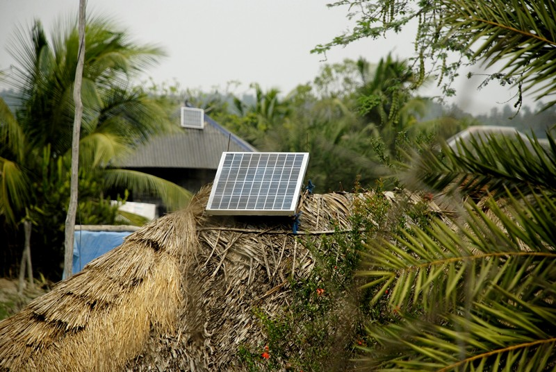 A solar power panel on the roof of a home in Bangladesh