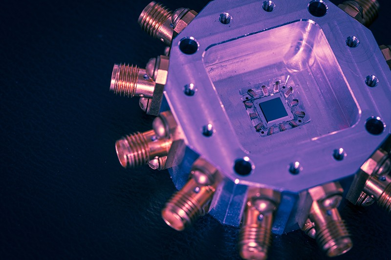 A false colour quantum computer chip on a dark background.