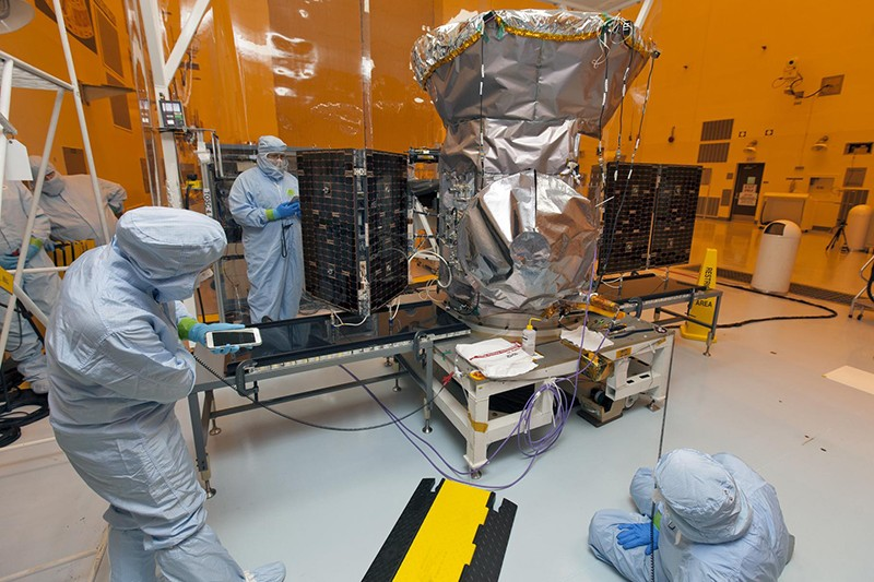 Technicians work on the TESS Satellite