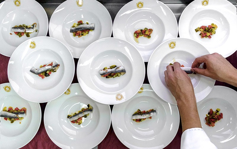 Small portions of fish and vegetables are plated on a luxury train travelling around Andalusia.