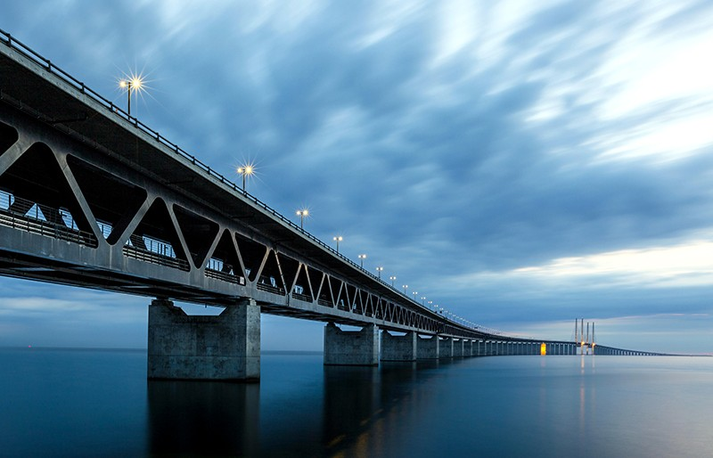 Photograph of Øresund Bridge, Europe's longest road and rail bridge, in dim light.