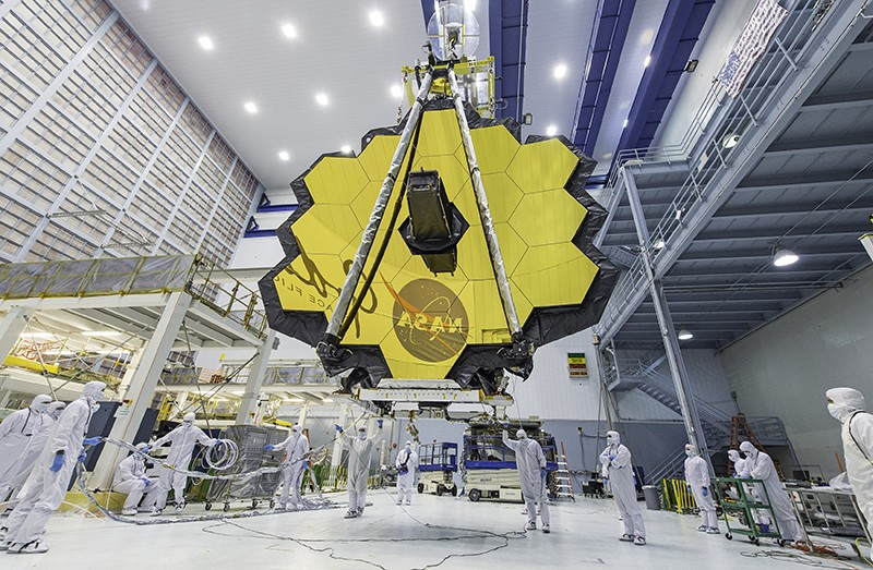 NASA technicians lift the telescope into a clean room using a crane in April 2017.