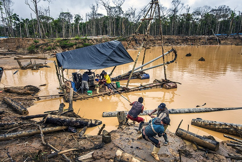 Workers in an illegal gold mine in Tambopata Natural Reverve in December 2014.