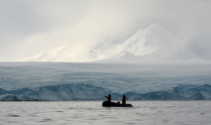 Researchers in a small boat in the Antarctic