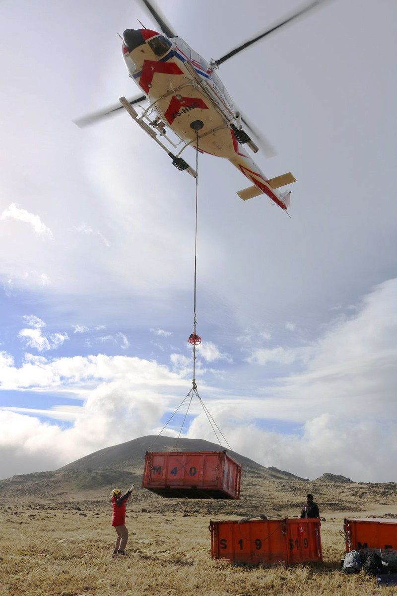 Helicopter delivering container to Marion Island