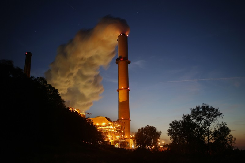 Emissions rise from a coal-fired power station at night