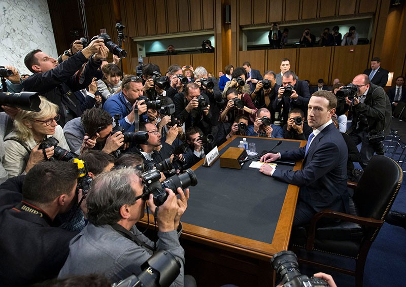 CEO of Facebook Mark Zuckerberg (R) takes his seat to testify before a Senate joint hearing on 10th April 2018.