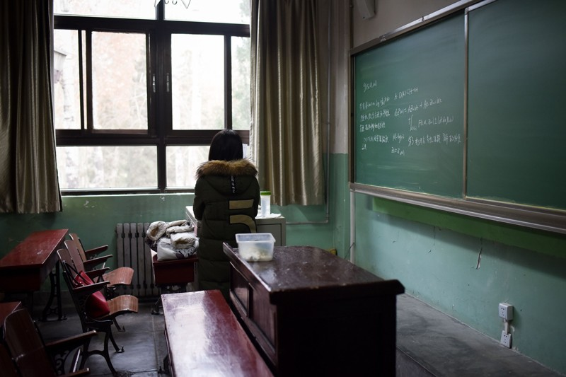 A female student in a classroom at Beihang University in Beijing.