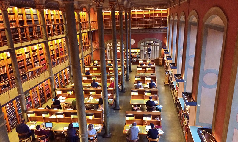 Aerial view of people reading at desks at the National Library of Sweden