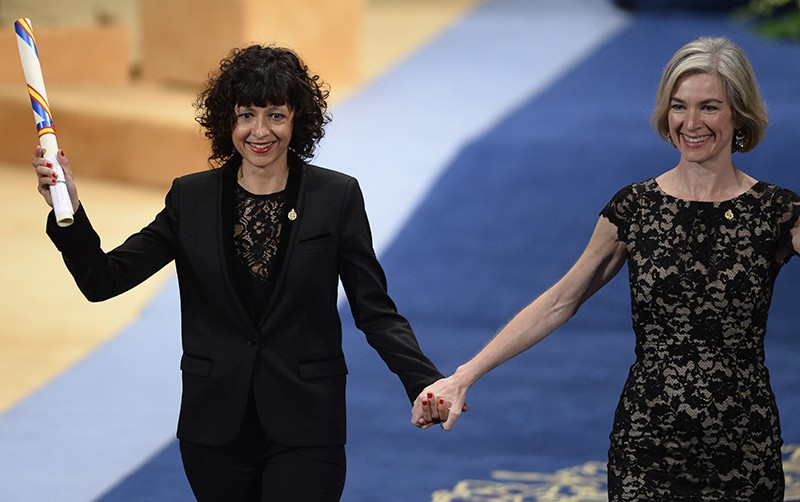 Emmanuelle Charpentier (L) and Jennifer Doudna celebrate on the stage after receiving a 2015 Princess of Asturias Award