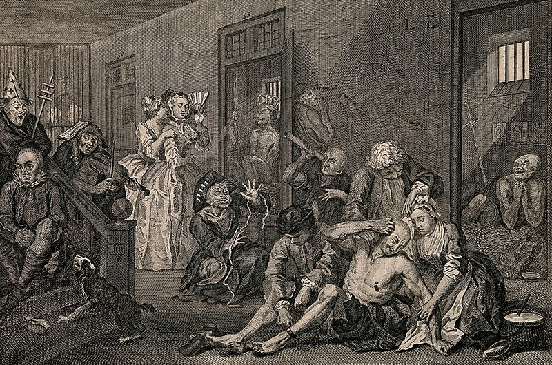 An engraving of an insane man and his crying lover at Bethlem Hospital in London by W. Hogarth, 1735.