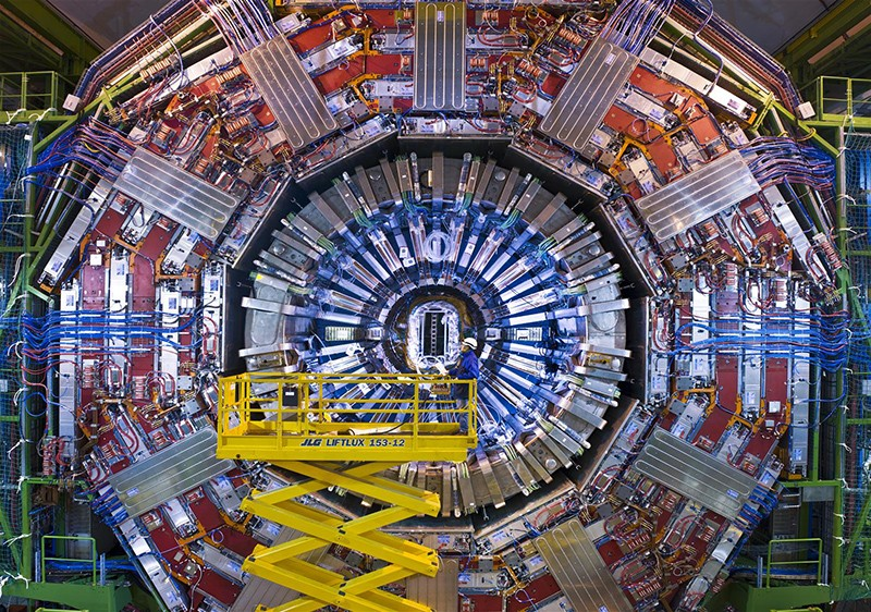 A man on a crane gazes at the CMS detector at the LHC at the end of 2007.