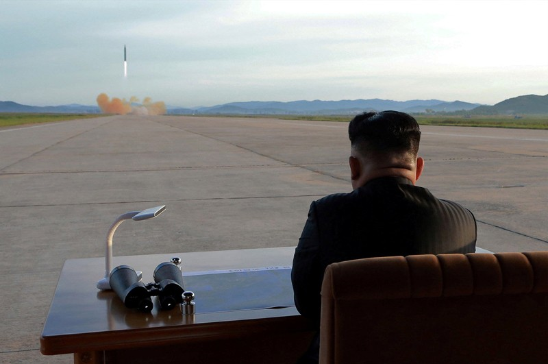 North Korean leader Kim Jong Un watches the launch of a Hwasong-12 missile