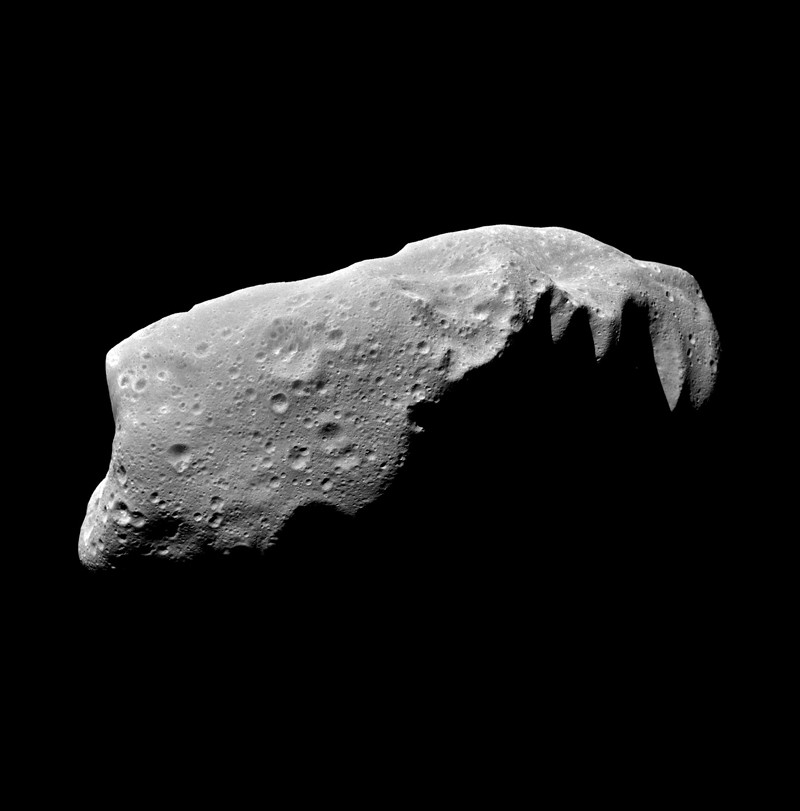 A grey, cratered asteroid against a black background.