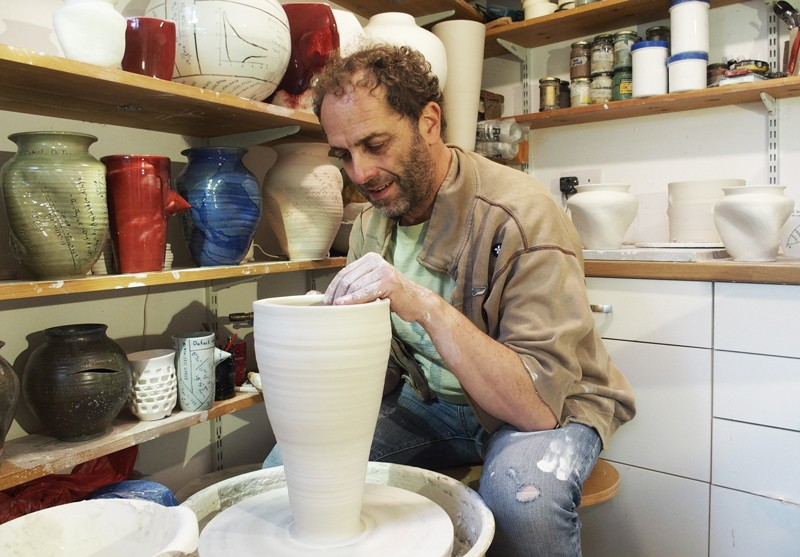 Nadav Drukker at the pottery wheel