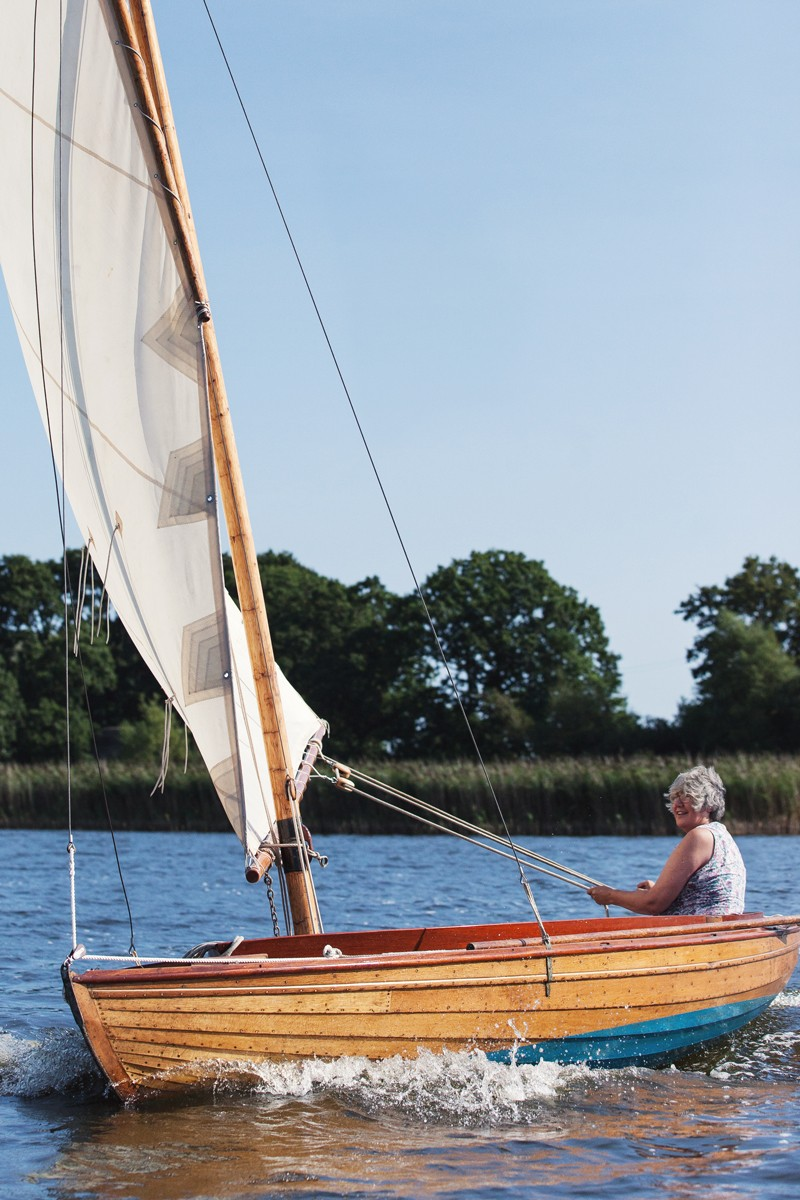 Anne Louise Kinmonth sailing her boat