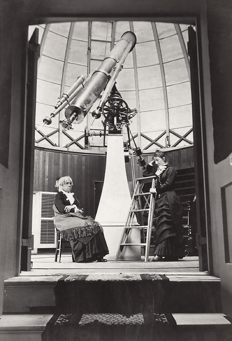 Maria Mitchell, seated at left, and her student Mary Whitney, standing at right, in front of the Fitz telescope.