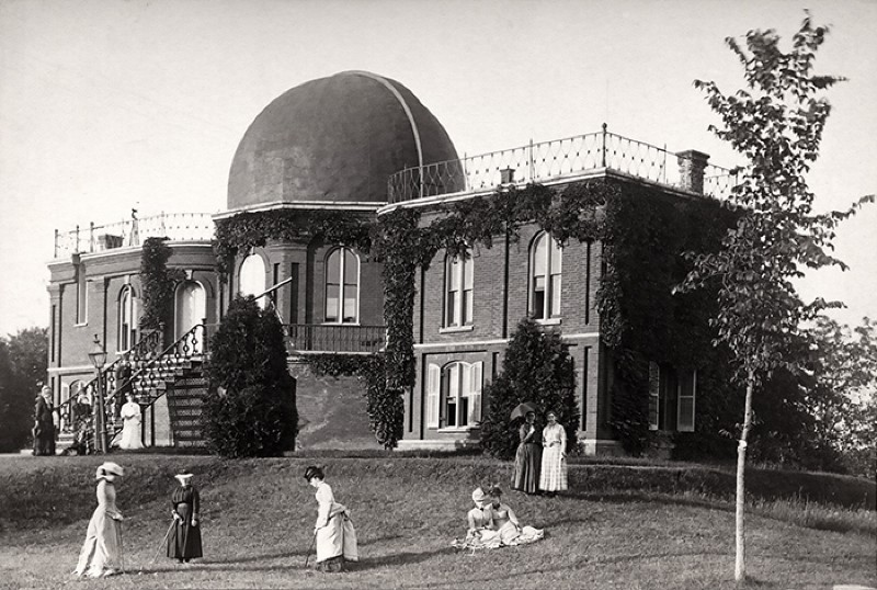 Female Vassar students walking and playing croquet on the grounds of the old observatory in 1879.