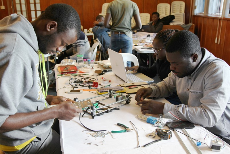 Participants learn how to build lab equipment at a workshop