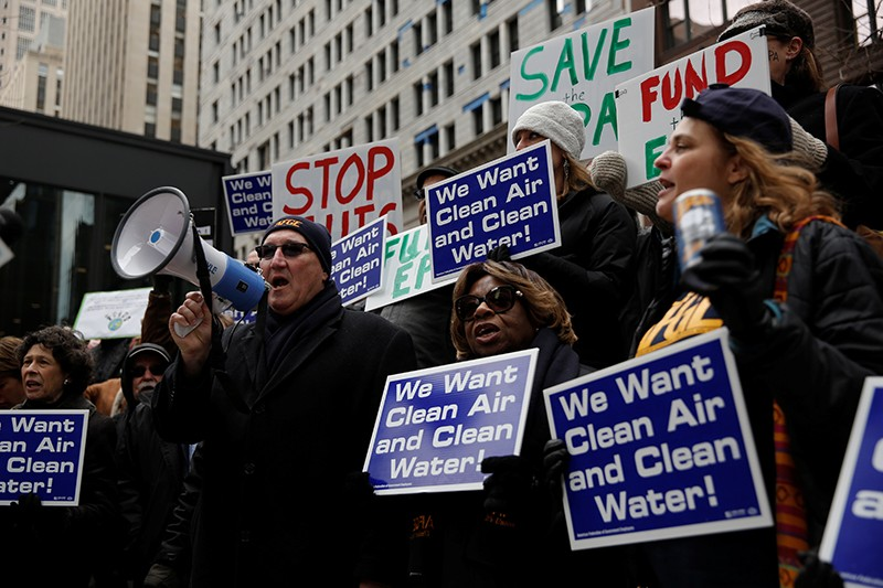 AFGE Local 704 union president Michael Mikulka speaks as EPA workers protest job cuts at a rally in Chicago, March 2017
