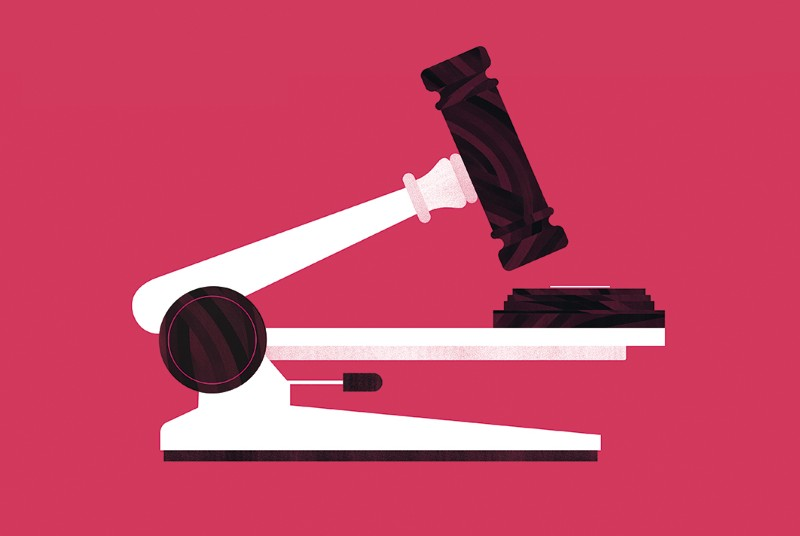 A gavel and block disguised as a microscope.