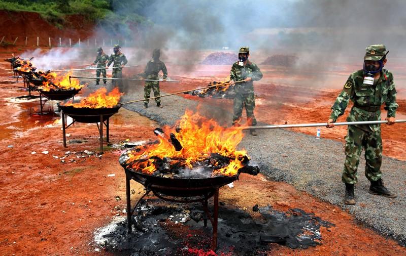 Seized drugs burned, Mangshi City, capital of Dehong Dai and Jingpo Autonomous Prefecture, Yunnan Province, China - 26 Jun 2017