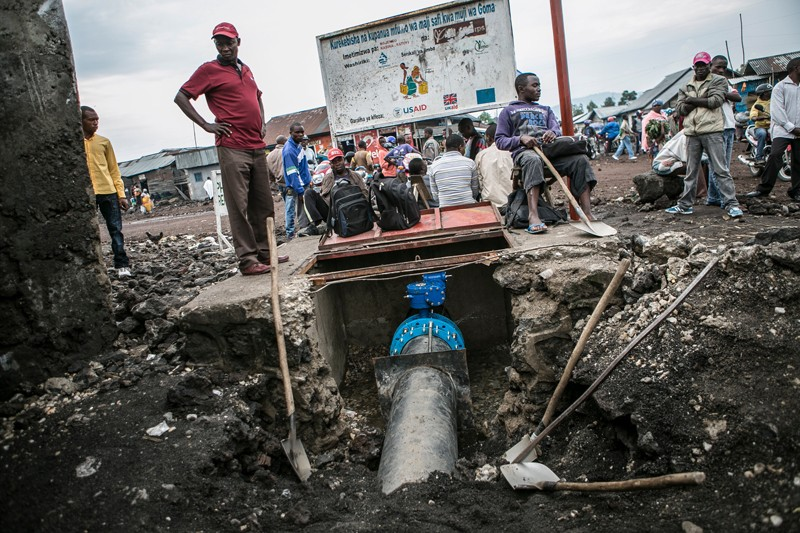 Laborers work on a broken water pipe in Goma, Democratic Republic of Congo