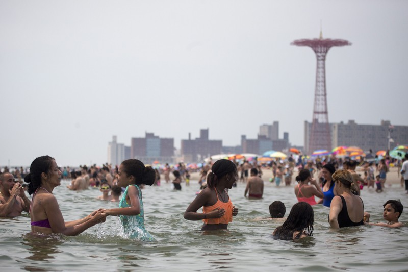 Crowds take to the water on a hot afternoon at Coney Island in New York, July 1, 2018.