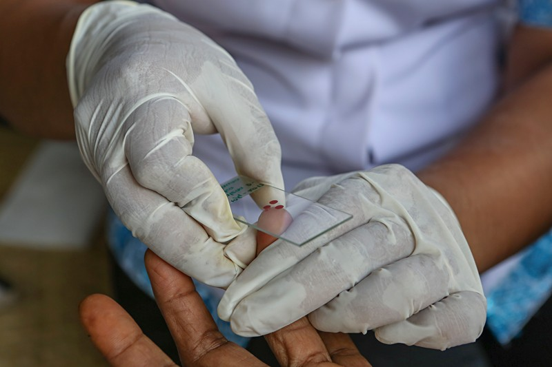 A blood sample is taken at an Indonesian malaria clinic