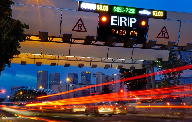 Cars pass through the Electronic Road Pricing gantry in Singapre