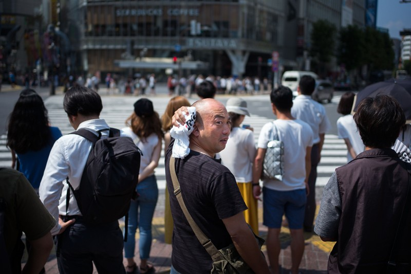 A man wipes perspiration from his head in Tokyo