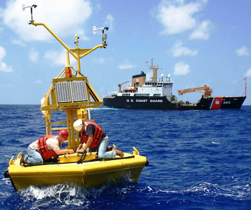 Maintenance workers on an ocean buoy