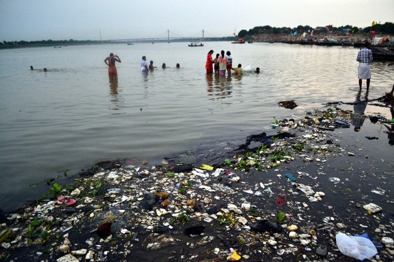 Indian devotees take a holy dip on the polluted river banks of River Ganges, in Allahabad.