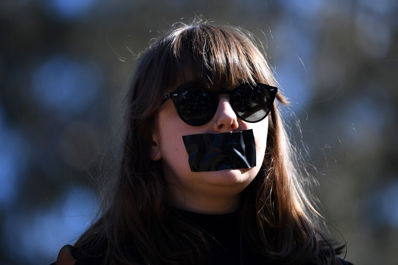 A student of the Australian National University participates in a protest
