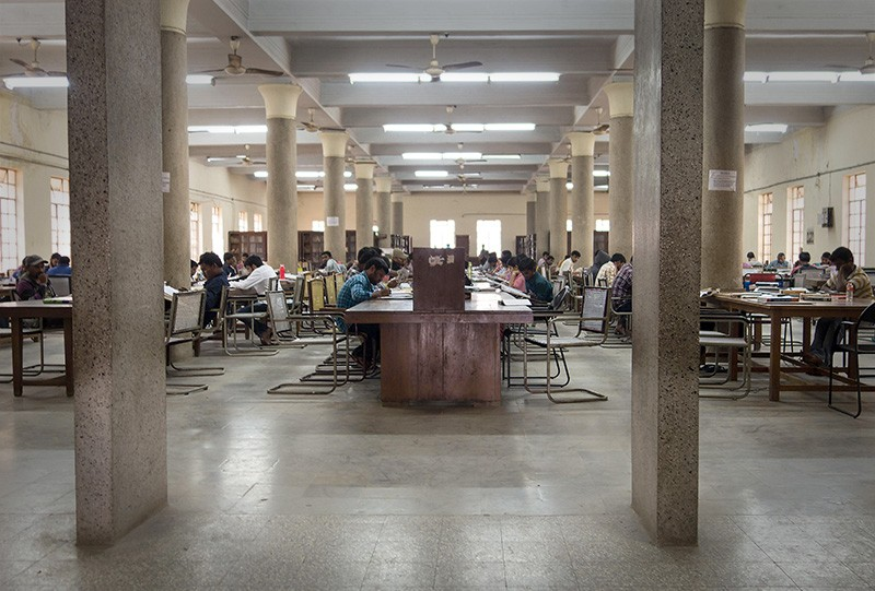 Students reading in rows at the reading room at Osmania University in Hyderabad, India in 2017.