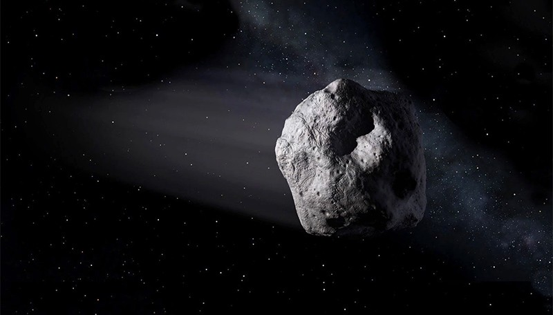 Illustration of a near-Earth object: a grey meteor with stars in the background.