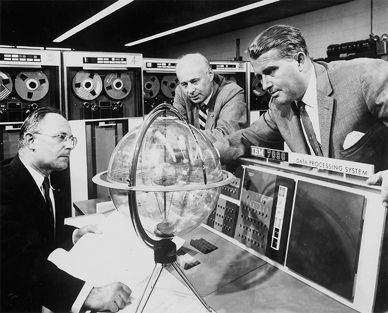 Werner von Braun (right), German born rocket pioneer, 1944, looks at scientific equipment with two other men