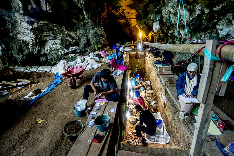 People excavating a cave in Indonesia