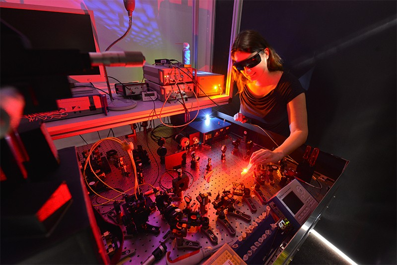 Photo of physicist at Martin Luther University using a laser