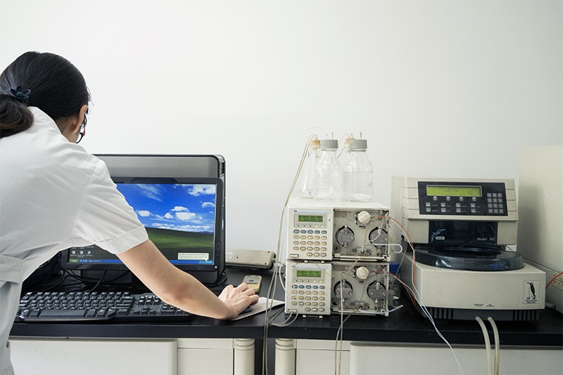 A scientist opens up her computer in a laboratory in China.