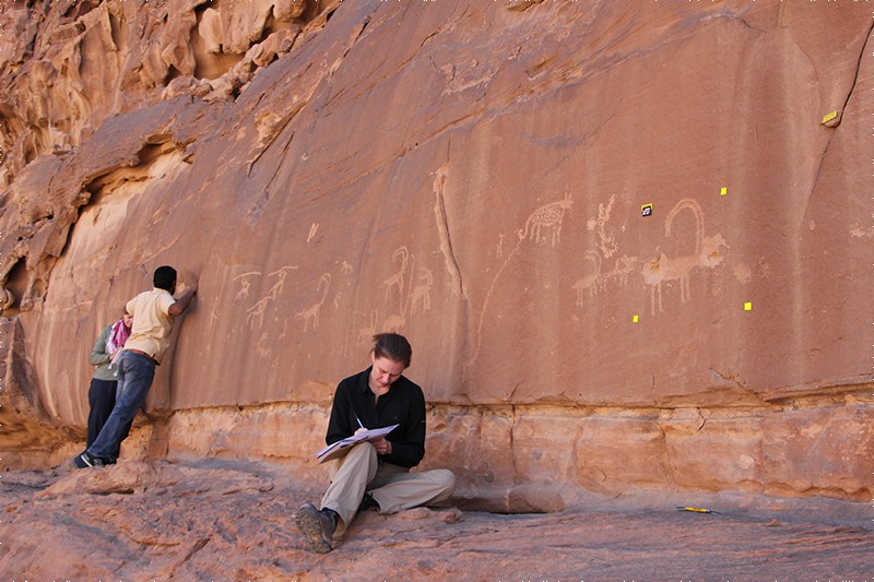 L-R: Lisa Mol, Mohammed Al Zalabih and Rachel King (seated) examine site 6 at Wadi Rum, Jordan.