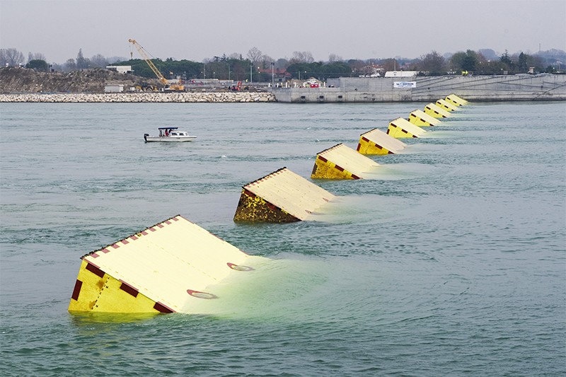Huge yellow blocks, the gates of MOSE, emerge during technical tests in Venice's Lido in 2014
