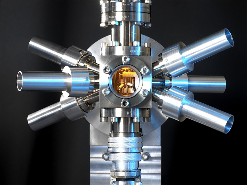 A strontium clock photographed on a dark background