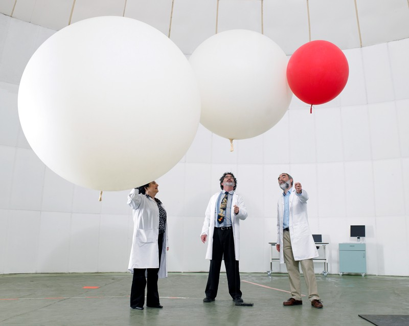 Scientists with balloons