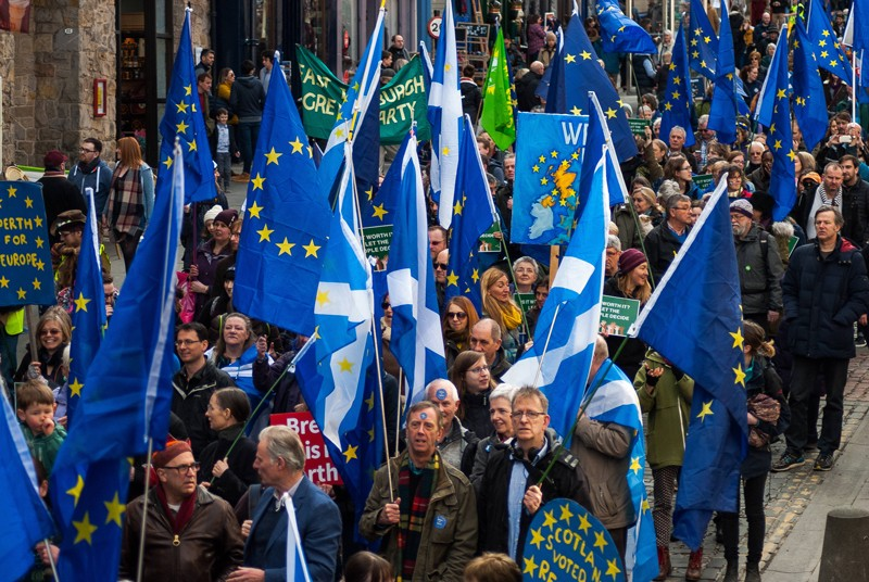 Protesters holding Scottish and European flags